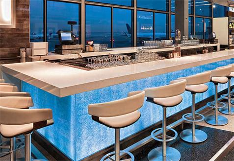 blue glass and acrylic solid surface countertop bar