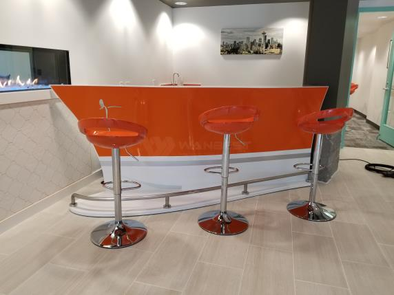 Orange boat shape bar counter custom design with stools